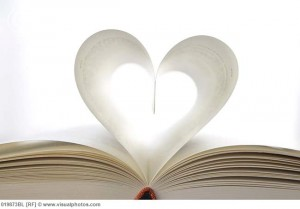 still life of book with pages forming heart